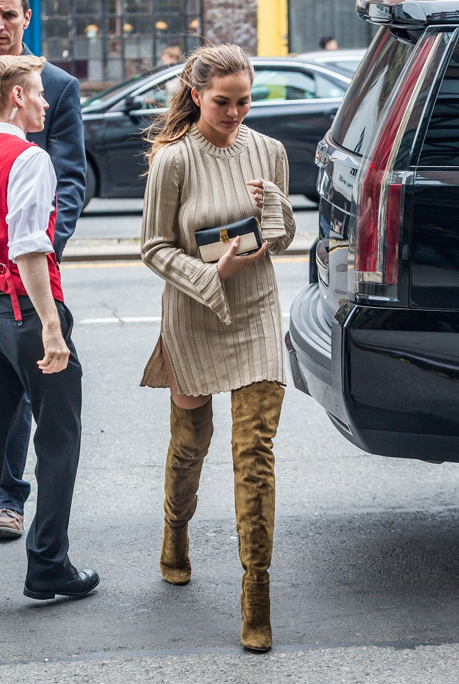 Chrissy Teigen in over the knee boots
