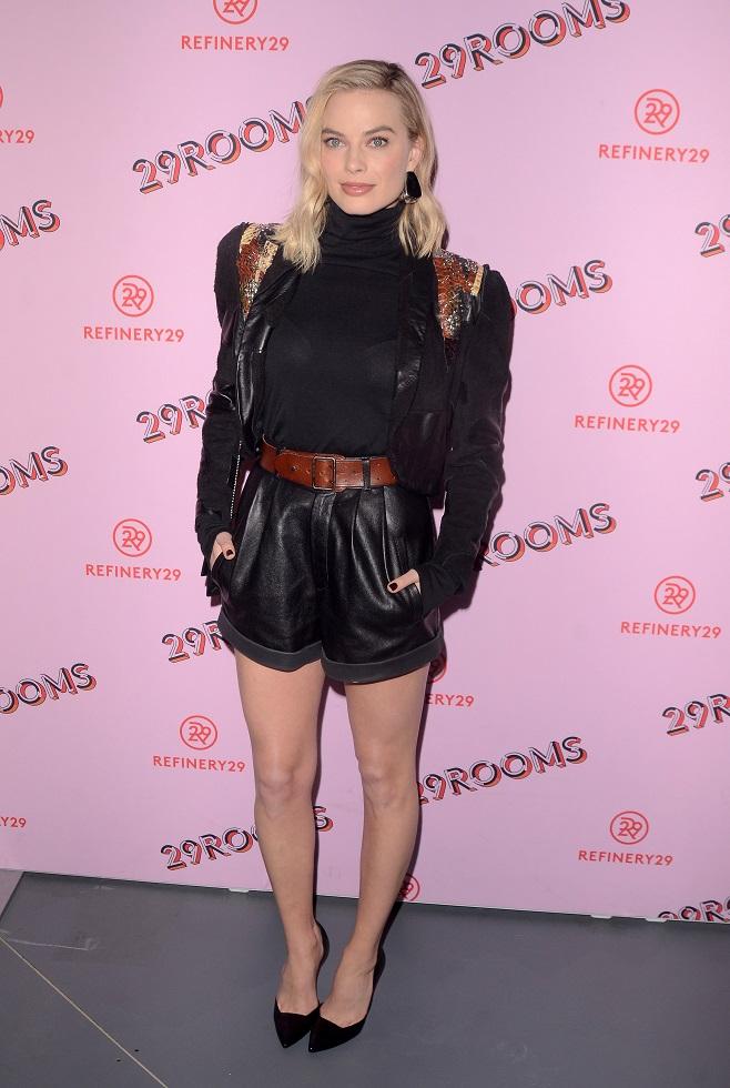 Margot Robbie in leather shorts