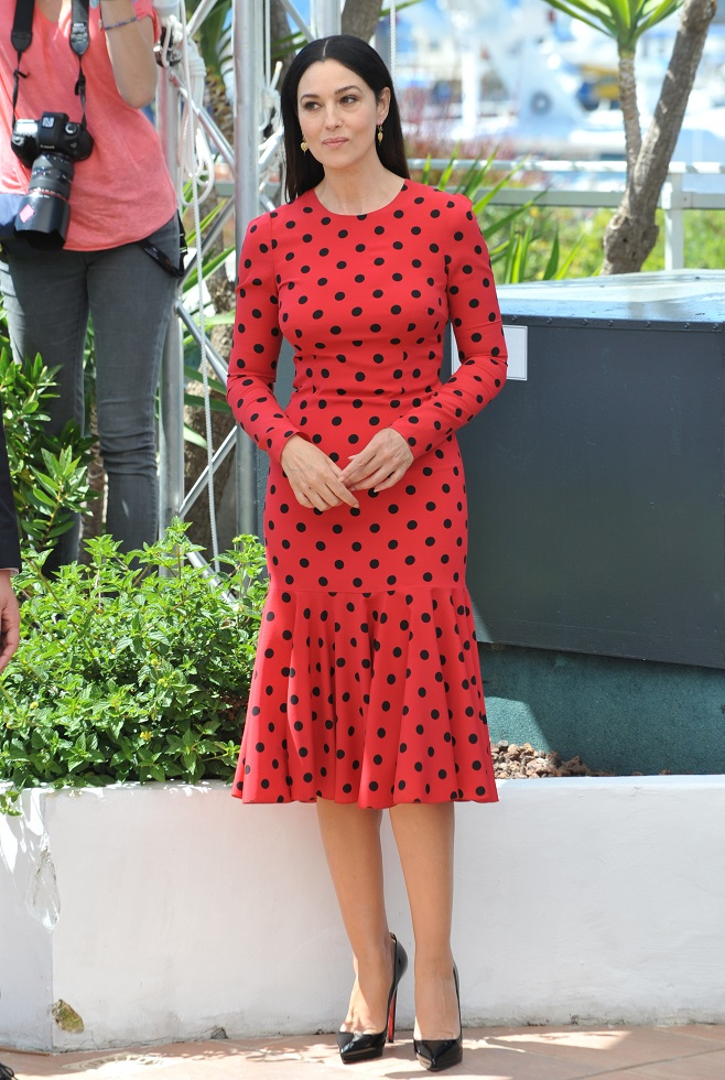 Monica Belluci in red polka dress