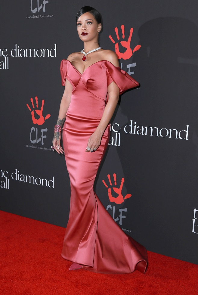Rihanna in red off shoulder dress